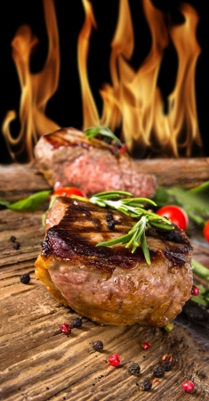 Grilled beef steaks with flames on background Stock Photo - 14006581