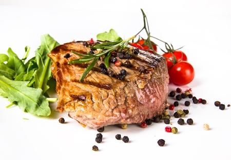 Beef steak medium grilled, isolated on white background photo