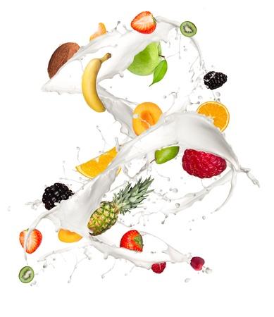 fruit drop: Fruit mix in milk splash, isolated on white background