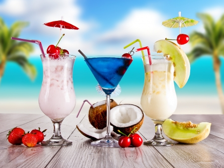 Summer drinks with blur beach on background photo