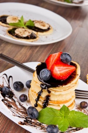 Sweet pancakes with chocolate  photo