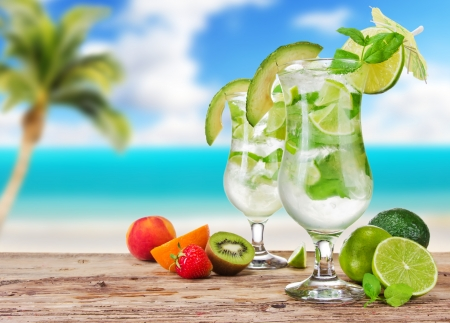 Mojito drinks with blur beach on background photo
