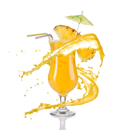 Fresh pineapple cocktail with juice splash, isolated on white background photo