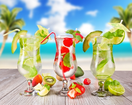 Mojitos drink with blur beach on background photo