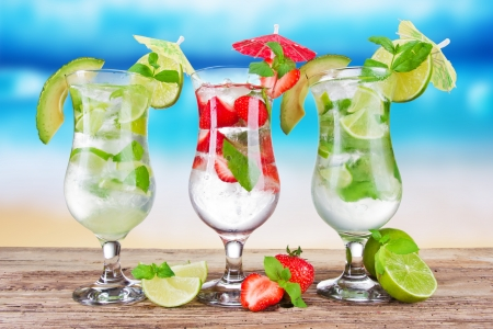 Mojitos drinks with blur beach on background photo