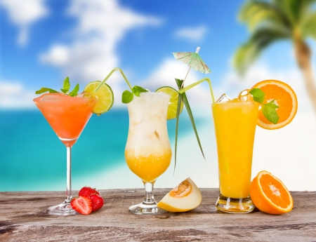 Summer cocktails with blur beach on background photo