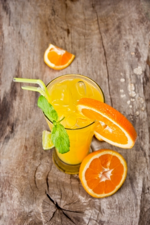 Orange cocktail on wood, top view photo
