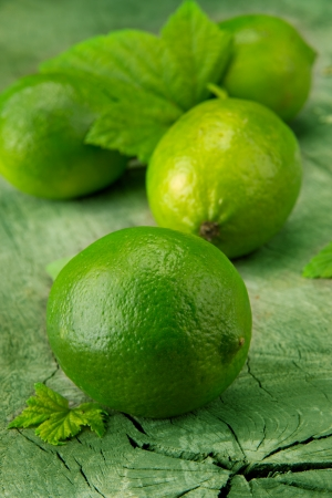 Fresh limes on wooden table photo