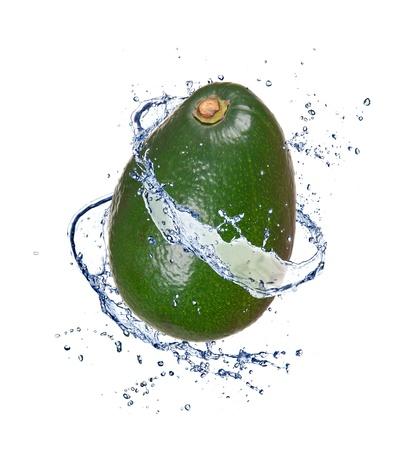 Avocado in water splash, isolated on white background photo
