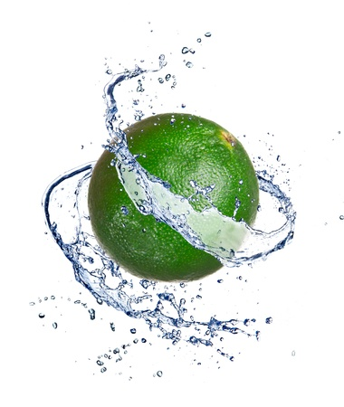 pour water: Lime in water splash, isolated on white background Stock Photo