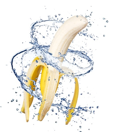 Banana in water splash, isolated on white background photo