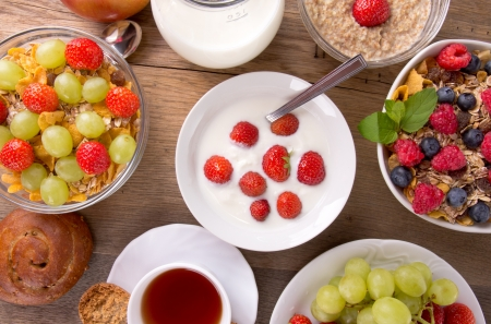 Healthy breakfast on wooden table, upper view photo