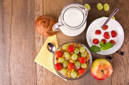 breakfast table: Healthy breakfast on wooden table, upper view