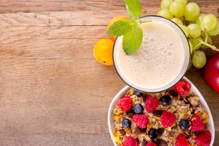 Healthy breakfast on wooden table, focused on drink. photo
