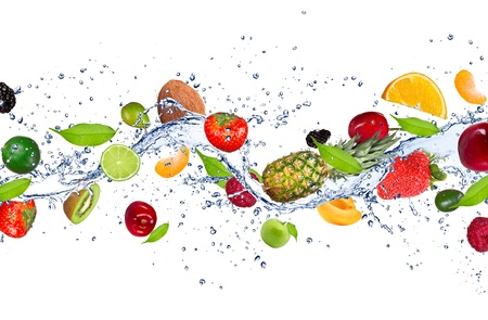 Fresh fruits falling in water splash, isolated on white background photo