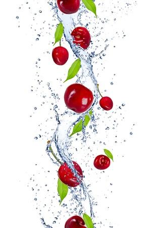 Fresh cherries falling in water splash, isolated on white background photo