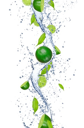 lime slice: Fresh limes falling in water splash, isolated on white background Stock Photo