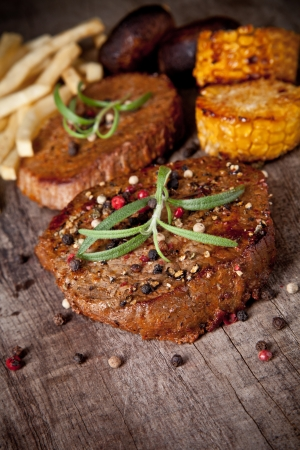 medium close up: Delicious beef steaks on wooden table