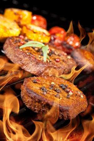 Delicious beef steaks on grill Stock Photo - 14815681