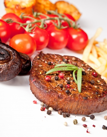 Delicious beef steak, isolated on white background photo