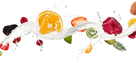Fruit mix in milk splash, isolated on white background photo
