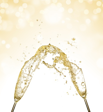Splashing champagne out of glasses, concept of celebration photo