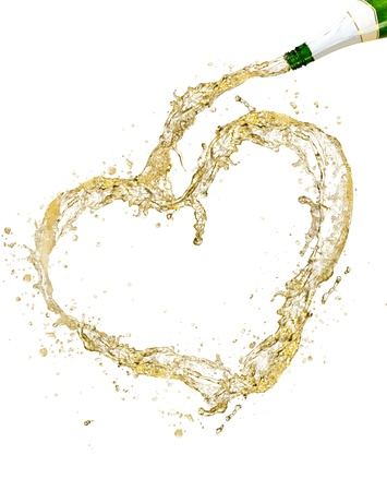 Splashing champagne heart symbol, isolated on white background photo