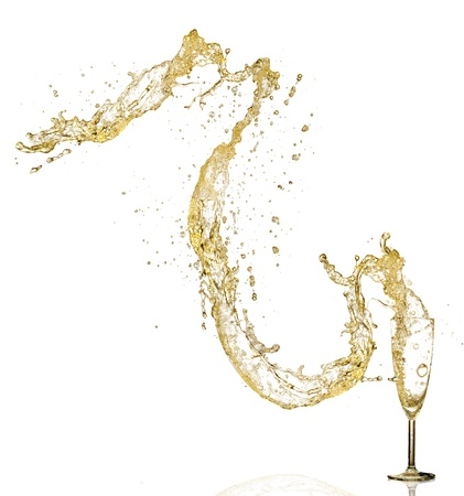 Splashing champagne out of glass, isolated on white background photo