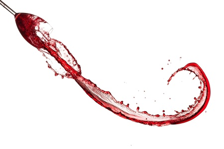 Red wine splashing out of glass, isolated on white background photo