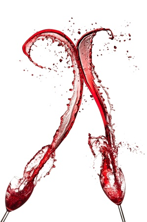 Red wine splashing out of glasses, isolated on white background photo