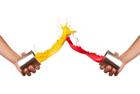 color mixing: Two painters splashing pait from cans, isolated on white background