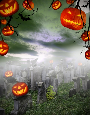 lawn party: Spooky halloween pumpkins on cemetery Stock Photo