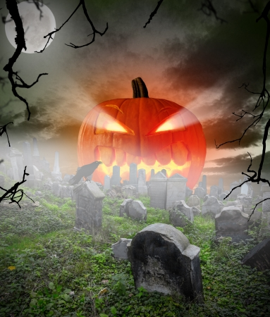cemetry: Spooky halloween pumpkin on cemetery Stock Photo