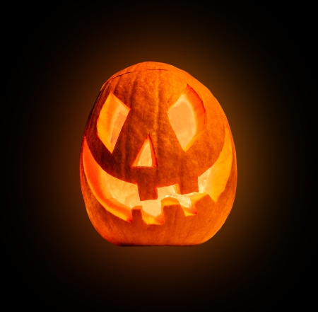 Evil halloween pumpkin, isolated on white background photo