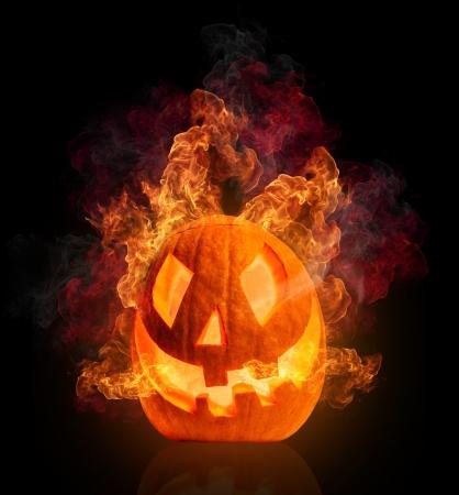 carved pumpkin: Burning halloween pumpkin, isolated on black background