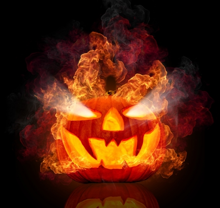 halloween background: Burning halloween pumpkin, isolated on black background