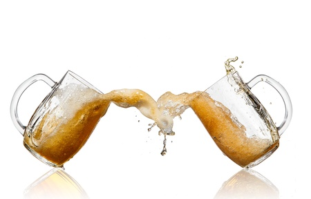 foam party: Beer splashing out of glasses, isolated on white background Stock Photo