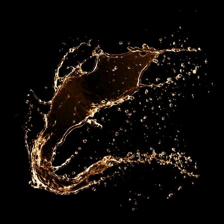 oil drops: Wavy splash, isolated on black background