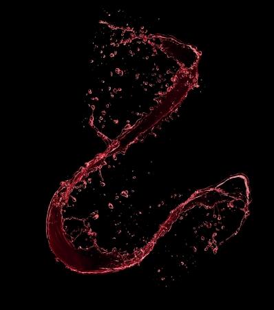 black liquid: Red wine splash, isolated on black background