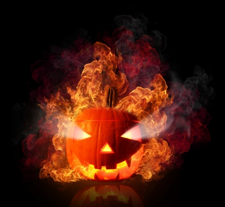 happy halloween:  Burning halloween pumpkin, isolated on black background