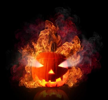 Burning halloween pumpkin, isolated on black background Stock Photo - 15572513