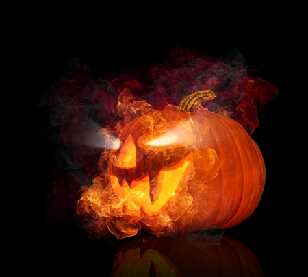 halloween pumpkin:  Burning halloween pumpkin, isolated on black background