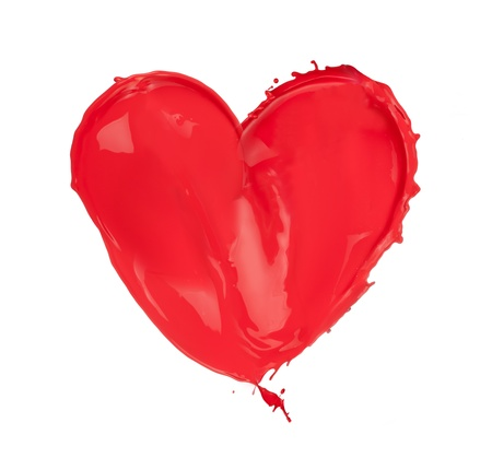 Red heart made of paint splashes, isolated on white background photo