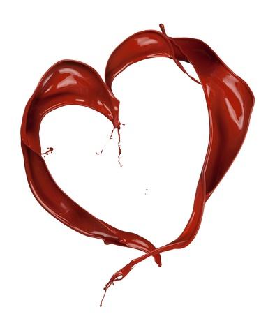 Heart symbol made of chocolate splashes photo