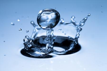 spews:  Macro shot of hydro-gel ball falling into water, shallow depth of focus