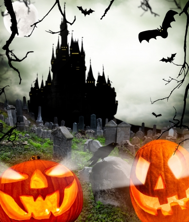 cemetry:  Spooky halloween pumpkins with castle silhouette on background