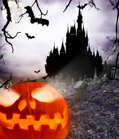 cemetry:  Spooky halloween pumpkin with castle silhouette on background