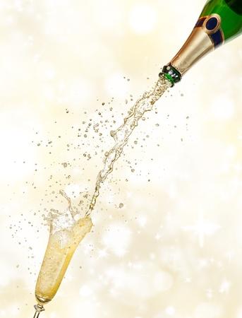 popping cork: Celebration theme on shiny blur background