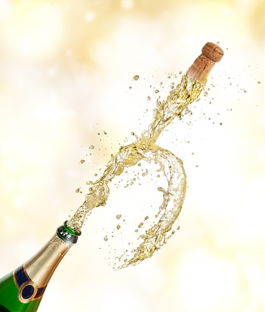 Champagne explosion with flying cork photo