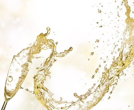 Champagne wine splashing out of glass Stock Photo - 15824274